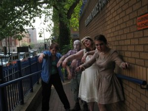 Four people in zombie fancy dress outside Belgravia Police station